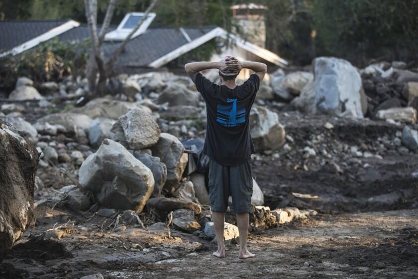 Travis Zehntner looks over the remains of destroyed homes on Glen Oaks Drive in Montecito on Jan. 11.