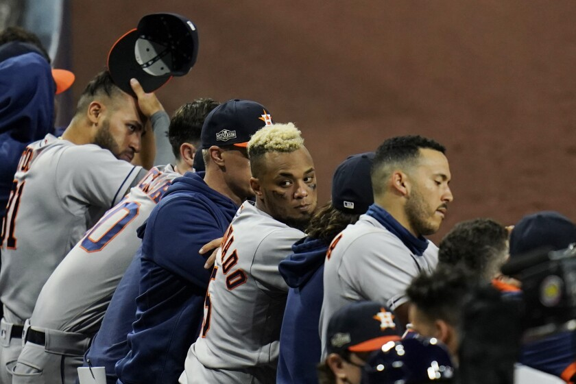The Houston Astros watch the top of the ninth inning against the Tampa Bay Rays in Game 1 of a baseball American League Championship Series, Sunday, Oct. 11, 2020, in San Diego. (AP Photo/Gregory Bull)