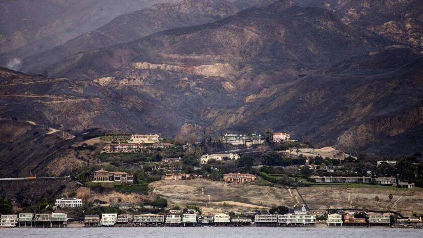MALIBU, CA --NOVEMBER 13, 2018 --The charred Santa Monica Mountains rise behind homes in Malibu,CA,