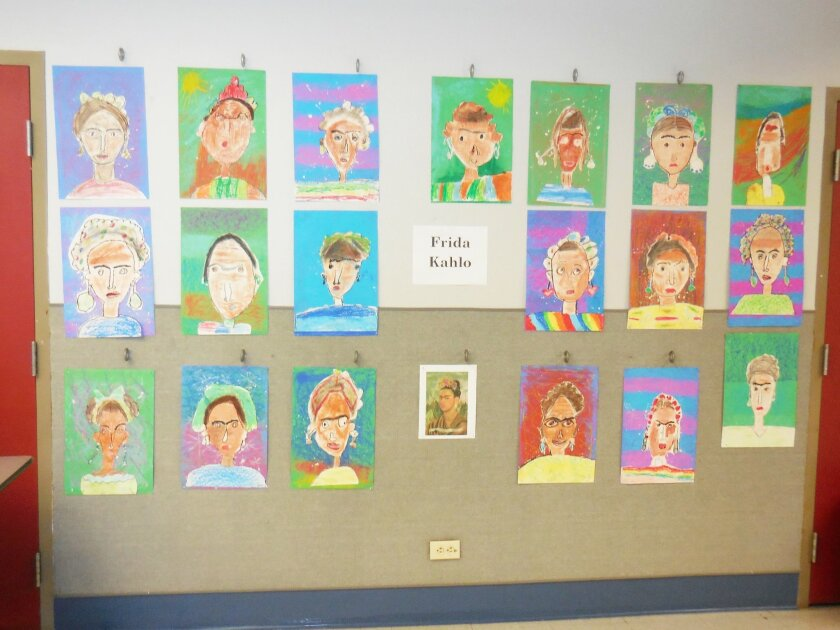 Portraits created by the students of Casa de Amistad's summer enrichment program after learning about artist Frida Kahlo.