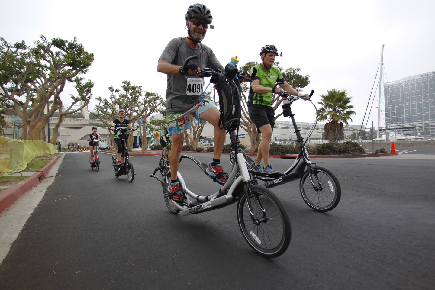 Several riders on Elliptigos cross the finish line for the Bike the Bay on Sunday.