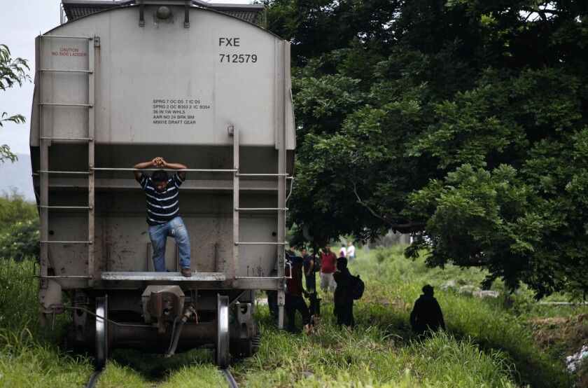 Migrants near Arriaga, Mexico, wait to board La Besta, or The Beast, the name for the infamous train that carries them northward.