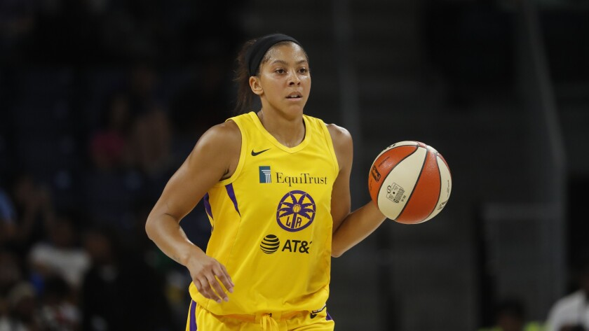 Sparks center Candace Parker brings the ball up court during a game against the Chicago Sky earlier this season.