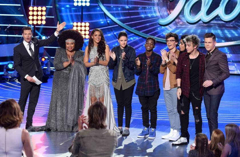 "Ryan Seacrest, left, shows off the ""American Idol"" Top 8, from left: La'Porsha Renae, Tristan McIntosh, Avalon Young, Lee Jean, MacKenzie Bourg, Sonika Vaid, Dalton Rapattoni and Trent Harmon."