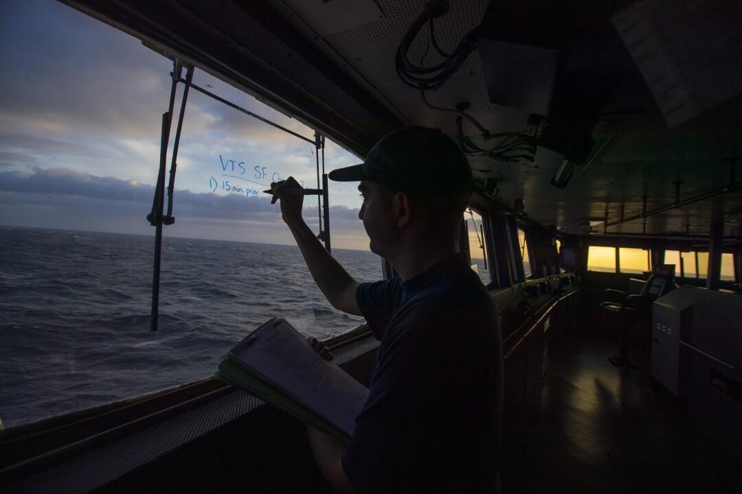 Sam Krakower writes coordinates on a windshield