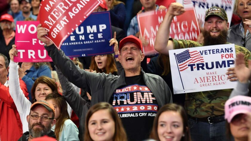 "Supporters of President Trump cheer during a ""Make America Great Again"" rally in Topeka, Kan., on Saturday."