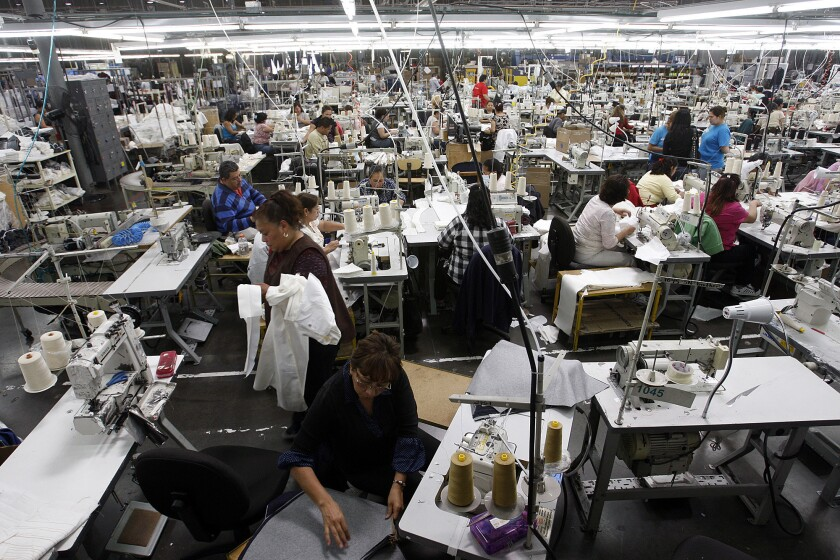 Manufacturing in the U.S. has become more competitive over the past decade compared with rivals such as China and Russia. Shown here at workers in an American Apparel garment dye factory in Southgate in 2012.