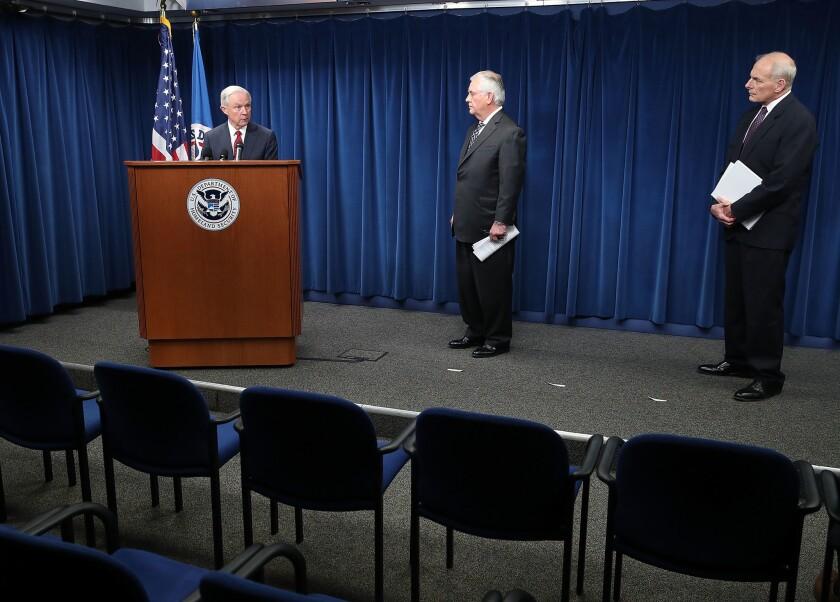 Atty. Gen. Jeff Sessions, left, speaks alongside Secretary of State Rex Tillerson, center, and Homeland Security Secretary John F. Kelly on Monday in Washington.