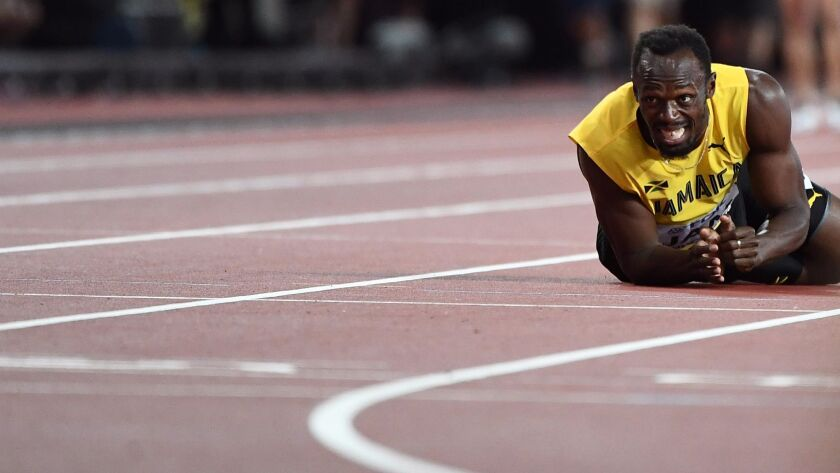 Jamaica's Usain Bolt lies on the track after pulling his hamstring on the anchor leg of the 4x100 relay at the World World Championships in London last month.