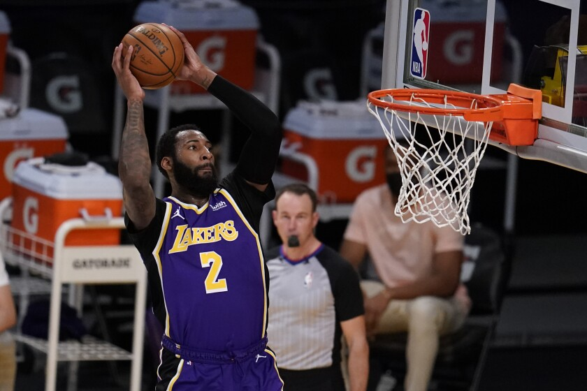 Lakers center Andre Drummond goes up for a two-handed dunk against the Kings.