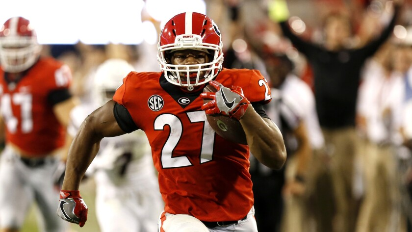 Georgia tailback Nick Chubb (27) runs on the way to a touchdown in the second half against Mississip