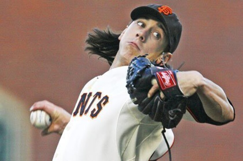 Giants ace Tim Lincecum had retired 13 straight batters when Tony Gwynn broke up his no-hitter in seventh inning. (Tony Avelar / Associated Press)