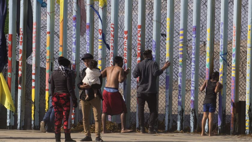 SAN DIEGO, CA- TIJUANA, MX 03-13-2019 U.S.-MEXICO BORDER WALL HONDURAN MIGRANTS BREAK THROUGH BORD