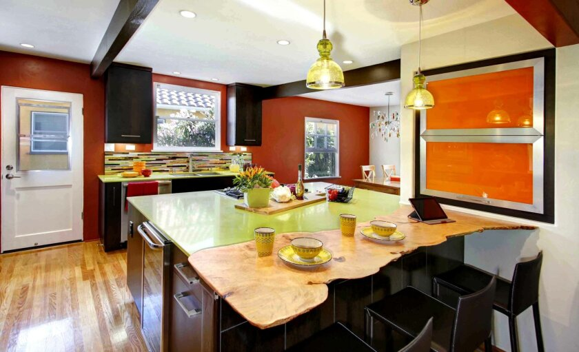 The new kitchen's focal point is an oversize island of Apple Martini-colored Caesarstone.