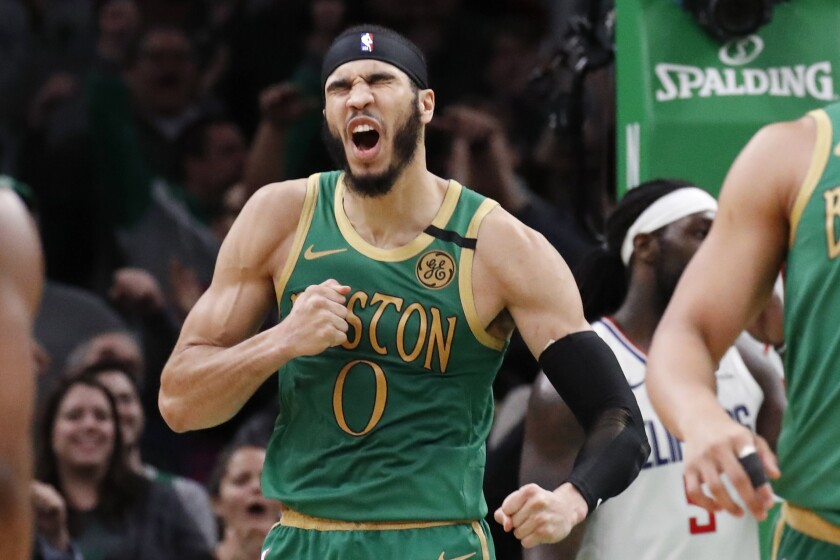 Boston Celtics forward Jayson Tatum (0) celebrates after his basket in the second overtime of an NBA basketball game against the Los Angeles Clippers, Thursday, Feb. 13, 2020, in Boston. (AP Photo/Elise Amendola)