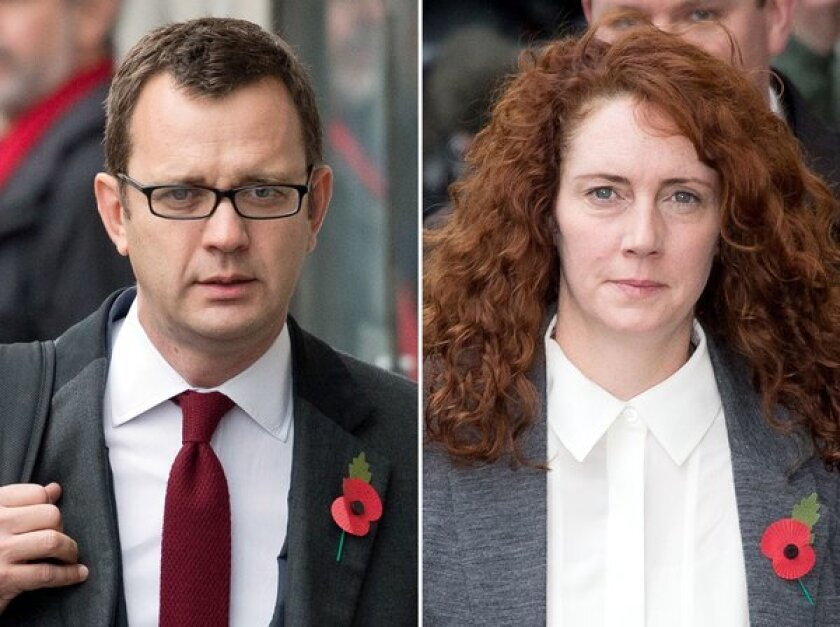 A combination of pictures shows former News of the World editor and Downing Street communications chief Andy Coulson, left, and former editor Rebekah Brooks arriving Thursday for their phone-hacking trial at the Old Bailey court in London.