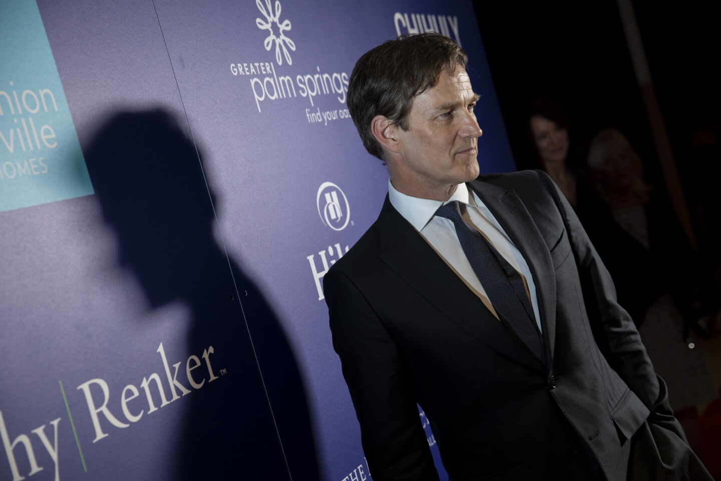 """Director Stephen Moyer poses on the carpet before the opening night screening of Kenneth Branagh's film, """"All is True,"""" at Palm Springs High School."""