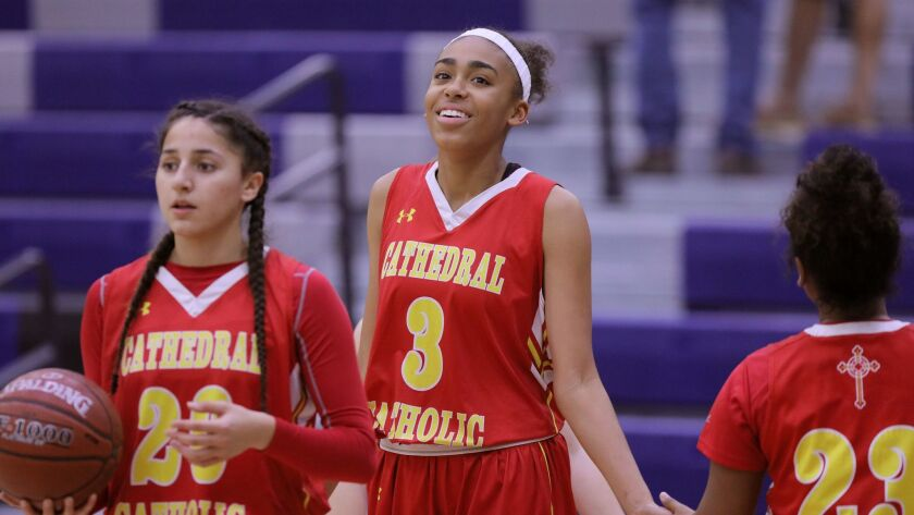 Cathedral Catholic's Mazatlan Harris (middle, shown in an earlier game) finished with a game-high 24 points.