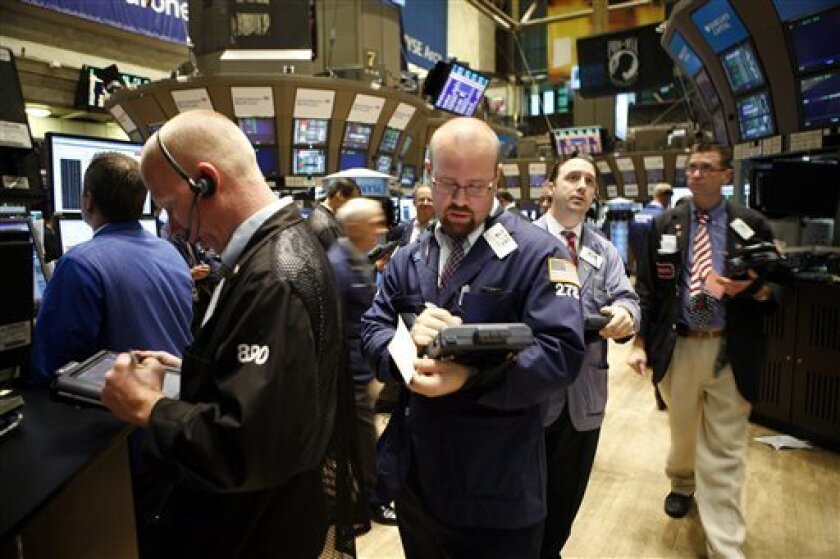 Traders and specialists work the trading floor of the New York Stock Exchange after the start of trading, Wednesday, Sept. 1, 2010, in New York. The Dow Jones industrial average jumped nearly 115 points in early morning trading. Broad indexes also rose more than 1 percent. (AP Photo/David Karp)