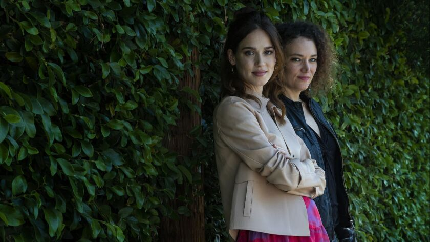"""Actress Matilda Lutz, left, shown with writer-director Coralie Fargeat, stars in Fargeat's critically acclaimed vengeance thriller """"Revenge,"""" in theaters and streaming May 11."""