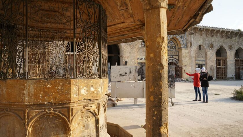 A washing or ablution fountain erected centuries ago in the mosque complex's plaza is among the stru