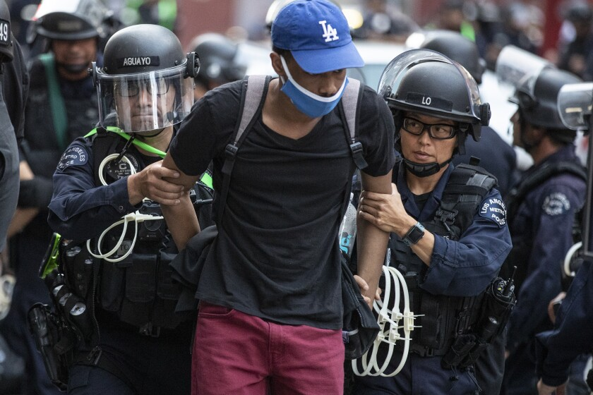 Dozens of protesters are arrested June 2 for curfew violations in Los Angeles.