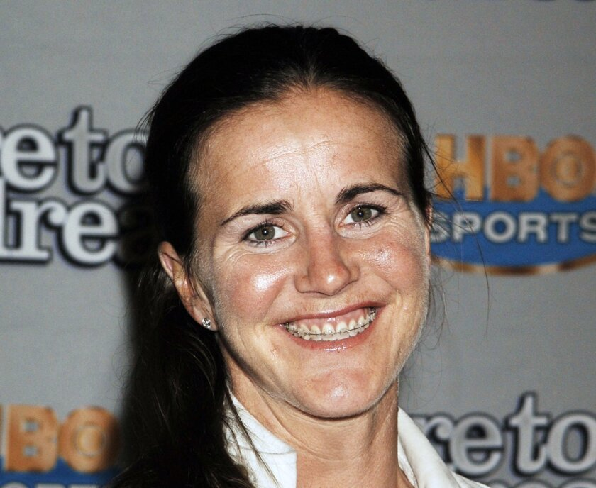 """FILE - This Nov. 29, 2005, file photo shows U.S Olympic gold medal soccer player Brandi Chastain arriving for the premiere of her HBO sports documentary """"Dare to Dream,"""" in New York. Chastain, who scored the game-winning penalty kick that gave the United States the 1999 Women's World Cup title, has"""