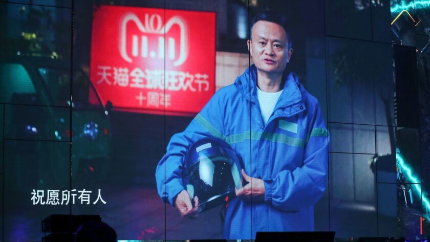 A screen shows a live image of Jack Ma, CEO of Chinese e-commerce giant Alibaba, as he greets audiences during the Singles Day shopping festival.