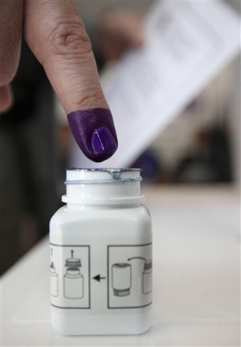 An Iraqi man, inks his finger after casting his vote at a polling center in Beirut, Lebanon, on Friday March 5, 2010. Iraqis living abroad have began casting ballots in their homeland's crucial parliamentary elections. The United Nations refugee agency estimates that around 2 million Iraqis are living abroad after fleeing since the 2003 U.S.-led invasion. (AP Photo/Bilal Hussein)