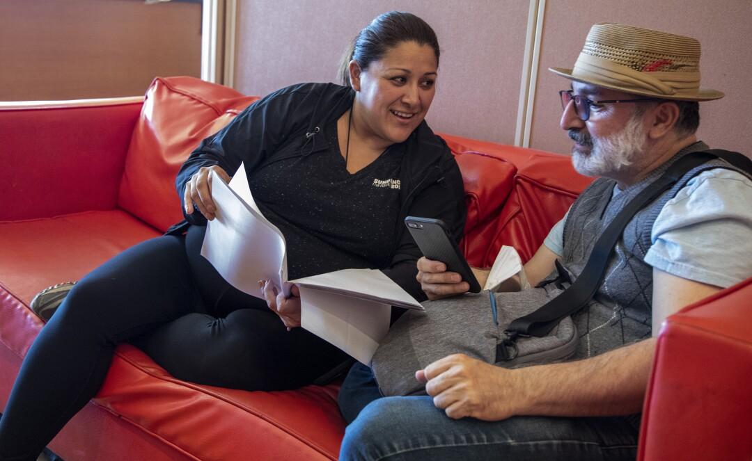 Yelyna De Leon, left, looks over a script with Edward Padilla at Casa 0101 Saturday, July 31, 2021 in Boyle Heights