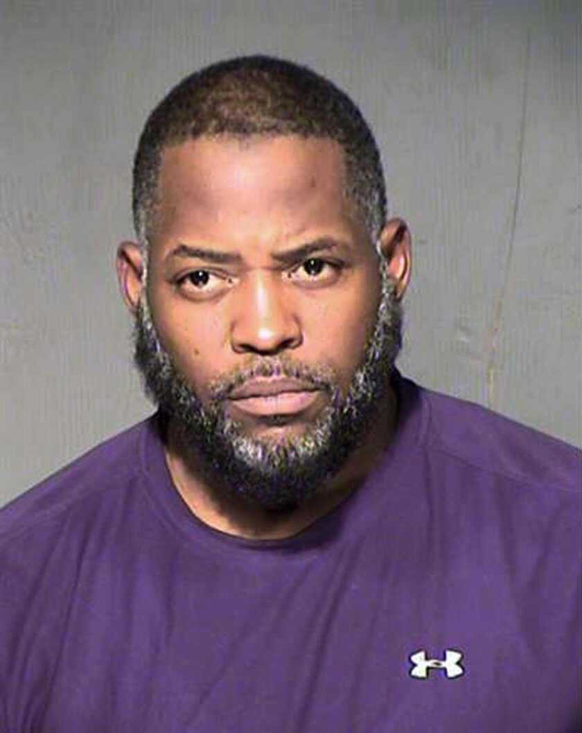 FILE - This undated file booking photo from the Maricopa County, Ariz., Sheriff's Department shows Abdul Malik Abdul Kareem. The Arizona man is set for trial Tuesday, Feb. 16, 2016, on terror charges linked to Islamic State. Kareem is accused of providing the guns used in an attack at a Prophet Muh