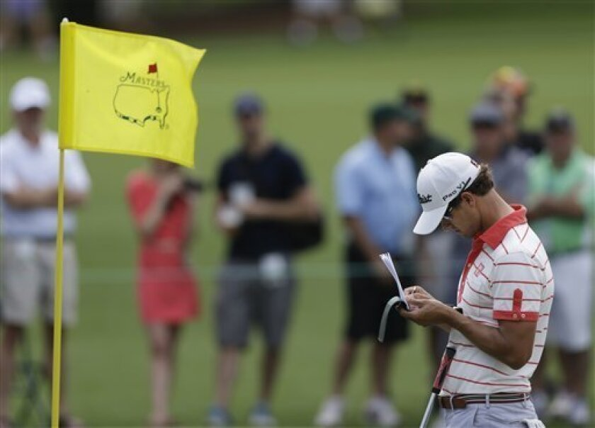 Adam Scott, of Australia, takes notes after putting on the 17th hole during a practice round for the Masters golf tournament Tuesday, April 9, 2013, in Augusta, Ga. (AP Photo/David Goldman)