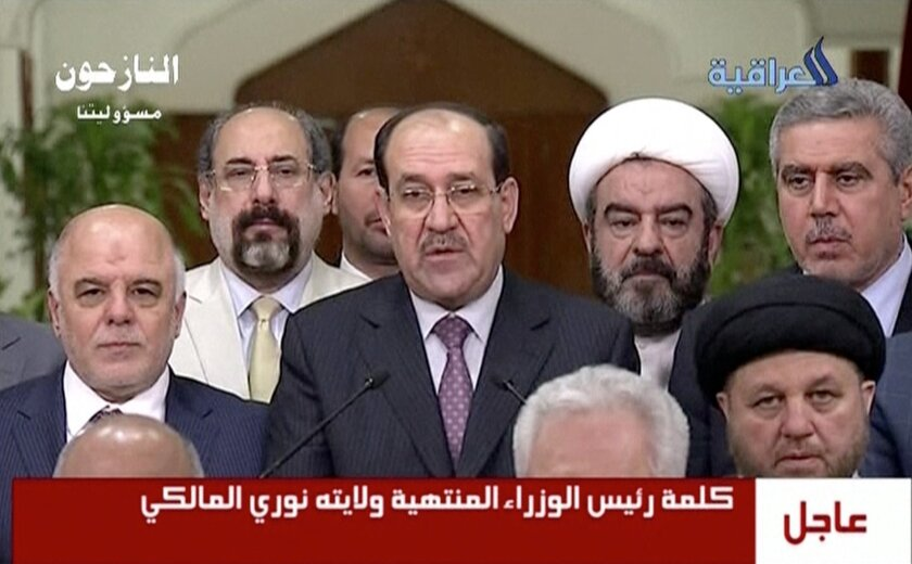 """In this image taken from video, Iraq's prime minister for the past eight years, Nouri al-Maliki, relinquishes his post to fellow Dawa Party member Haider al-Abadi, Thursday, Aug. 14, 2014, ending a political deadlock that has plunged the country into uncertainty as it fights a Sunni militant insurgency. Al-Maliki said the decision to back al-Abadi reflected his desire to """"safeguard the high interests of the country,"""" adding that he would not be the cause of any bloodshed. (AP Photo/Al Iraqiya via Associated Press Television) IRAQ OUT"""