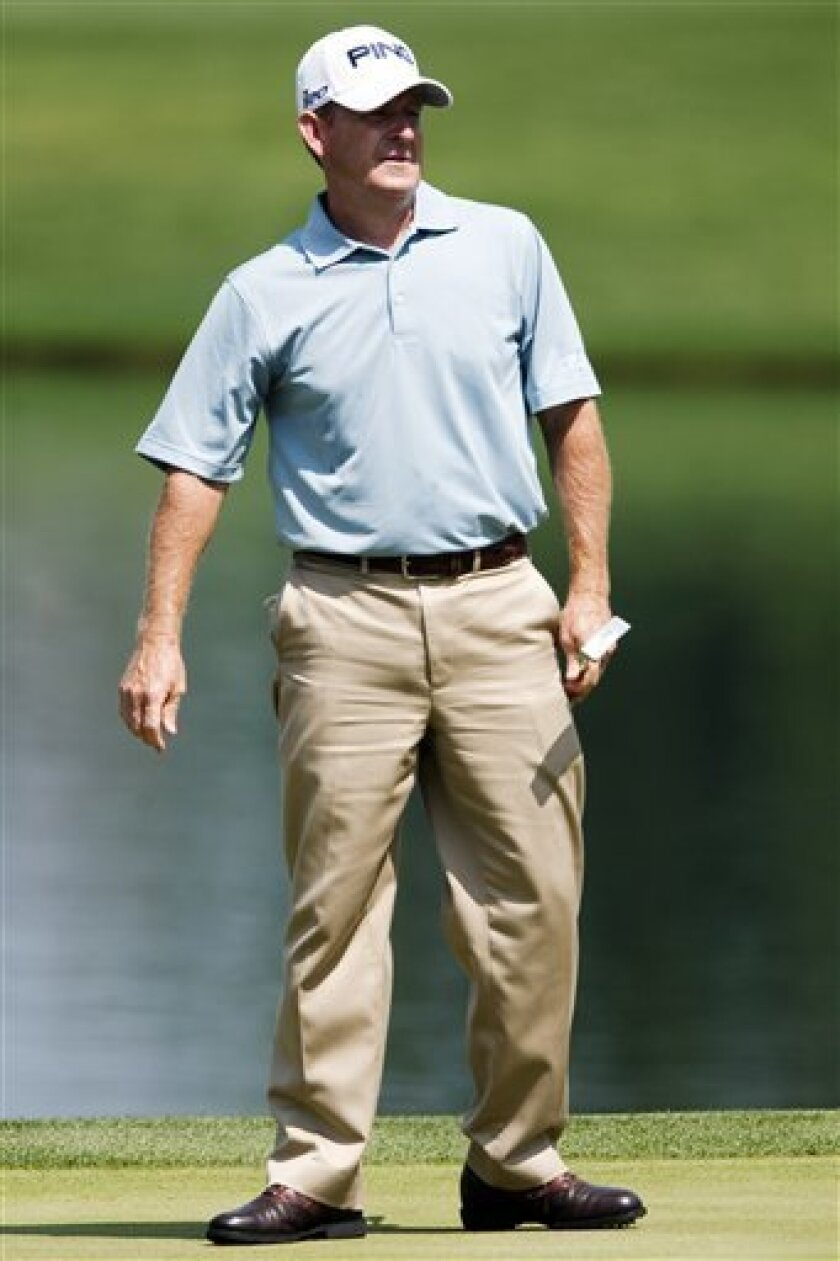 Jeff Maggert watches his putt on the second-hole green during the third round of the Houston Open golf tournament, Saturday, March 31, 2012, in Humble, Texas. (AP Photo/Eric Kayne)
