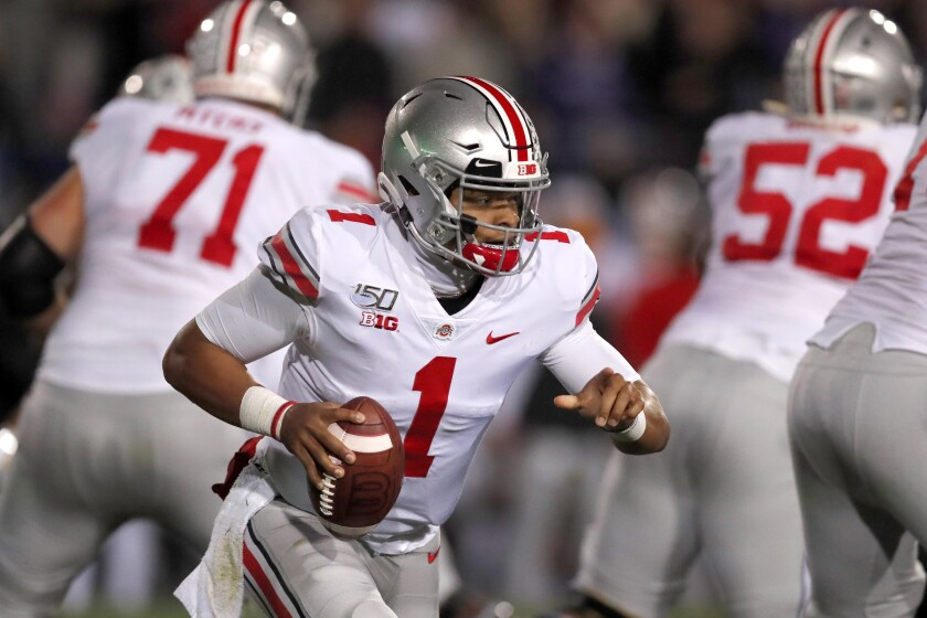 Ohio State quarterback Justin Fields scrambles during the Buckeyes' 52-3 victory over Northwestern on Oct. 18, 2019, in Evanston, Ill.