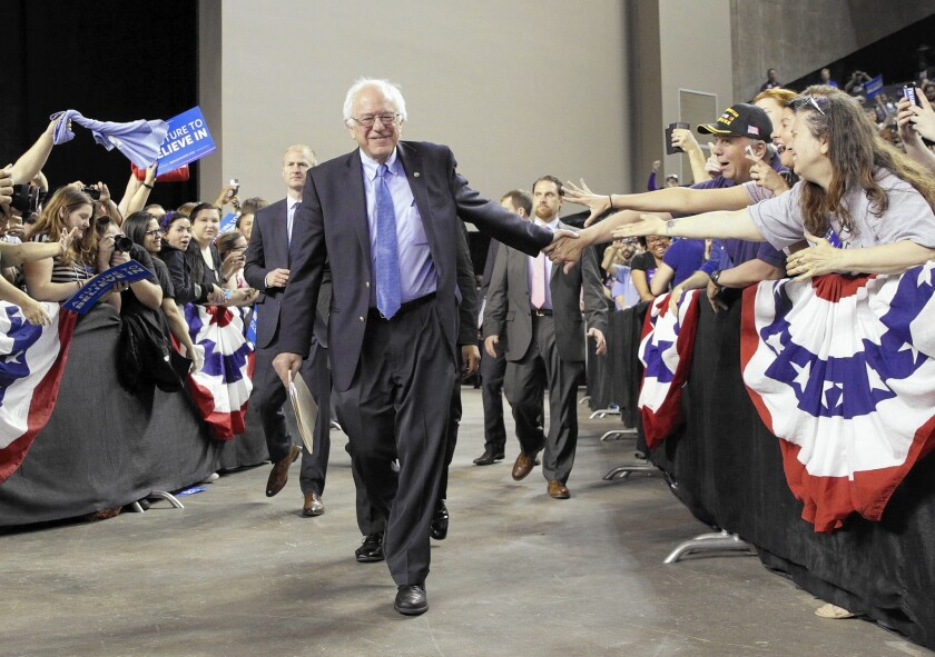 Bernie Sanders greets supporters at a rally in Baltimore