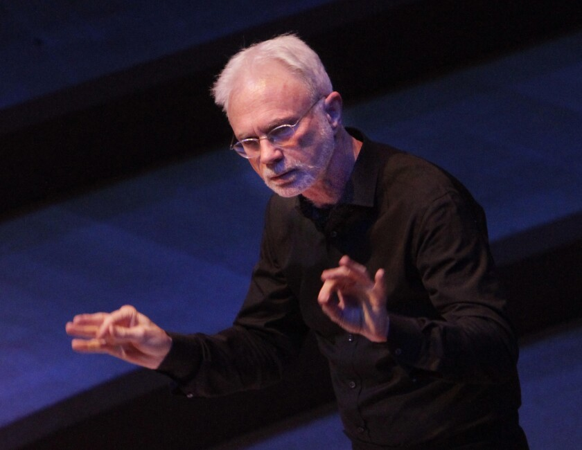 """John Adams, shown conducting at Walt Disney Concert Hall in Los Angeles in April, has condemned the Metropolitan Opera's decision to cancel an upcoming cinematic broadcast of """"The Death of Klinghoffer."""""""