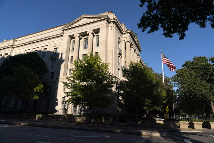 The American flag flies outside the Justice Department building