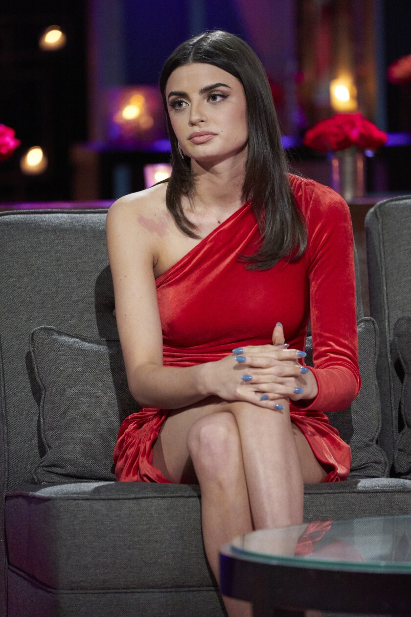 Woman in red dress sitting down