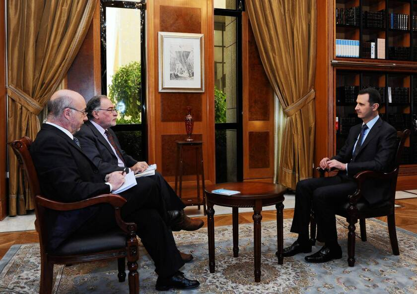 An a photo released by the official Syrian news agency, Argentine journalists interview President Bashar Assad in Damascus, Syria, on Saturday.