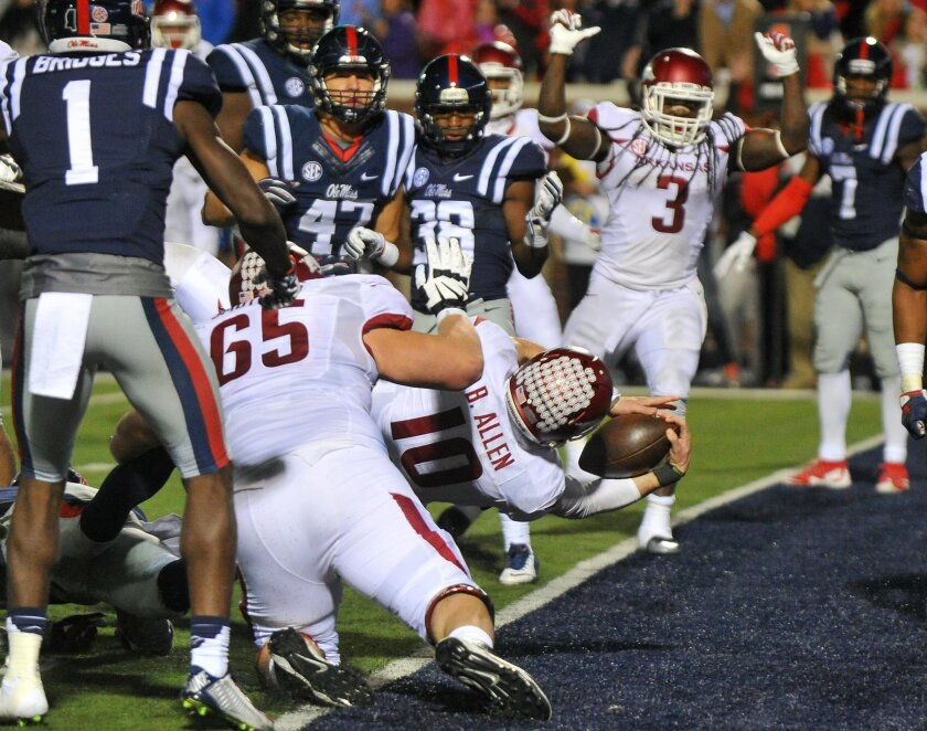 Arkansas quarterback Brandon Allen (10) dives in to the end zone for a 2-point conversion during overtime of an NCAA college football game against Mississippi in Oxford, Miss., Saturday, Nov. 7, 2015. Arkansas won 53-52 in overtime. (AP Photo/Thomas Graning)