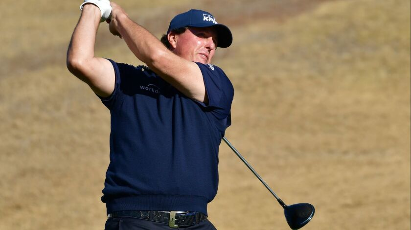 Phil Mickelson, playing on No. 8 at the Stadium Course on Saturday during the third round of the Desert Classic, managed to remain in the lead despite some wild shots.