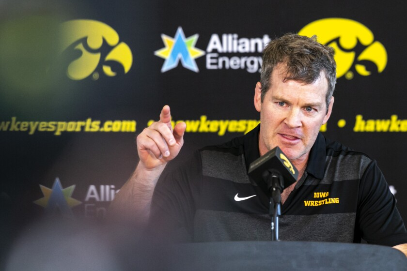 Iowa men's wrestling head coach Tom Brands speaks during a news conference announcing an NCAA college women's wrestling program for the Iowa Hawkeyes, Thursday, Sept. 23, 2021, at Carver-Hawkeye Arena in Iowa City, Iowa. (Joseph Cress/Iowa City Press-Citizen via AP)