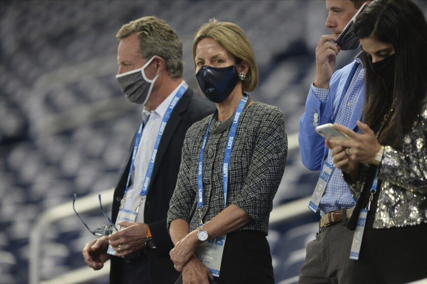 """FILE - In this Sept. 13, 2020, file photo, Sheila Ford Hamp, Detroit Lions principal owner and chairman, watches during the first half of the team's NFL football game against the Detroit Lions in Detroit. It took Hamp about one second to respond when asked about the potential for women in key roles in the NFL. """"The sky is the limit for anything females want to do,"""" said Hamp, who spoke at the league's fifth annual Women's Careers in Football Forum late last month. (AP Photo/Jose Juarez, File)"""
