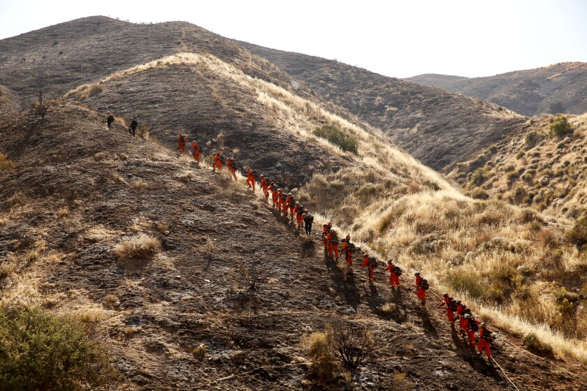 Firefighters prepare to battle the Soledad fire near Agua Dulce on Monday morning.