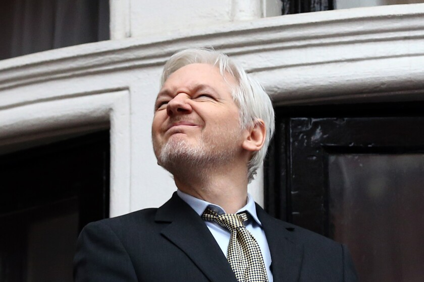 Wikileaks founder Julian Assange squints in the sunlight as he prepares to speak from the balcony of the Ecuador Embassy in London in February.