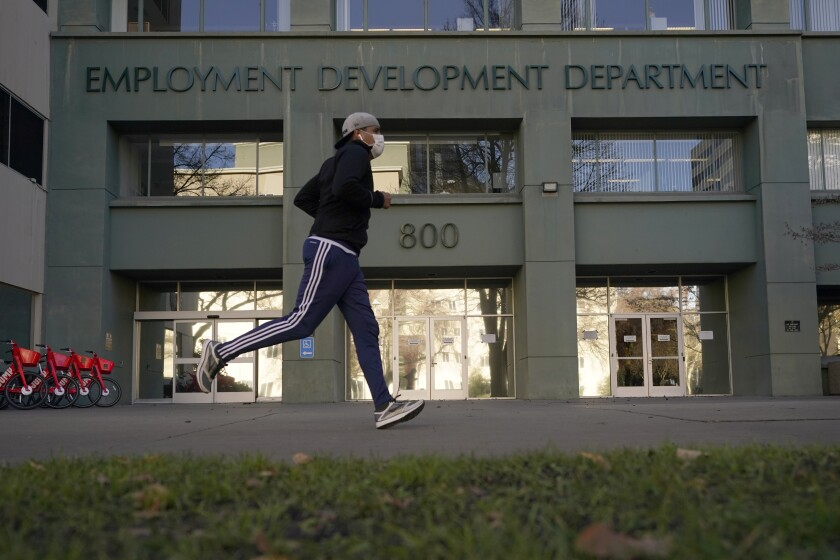 A jogger in front of the EDD office in Sacramento