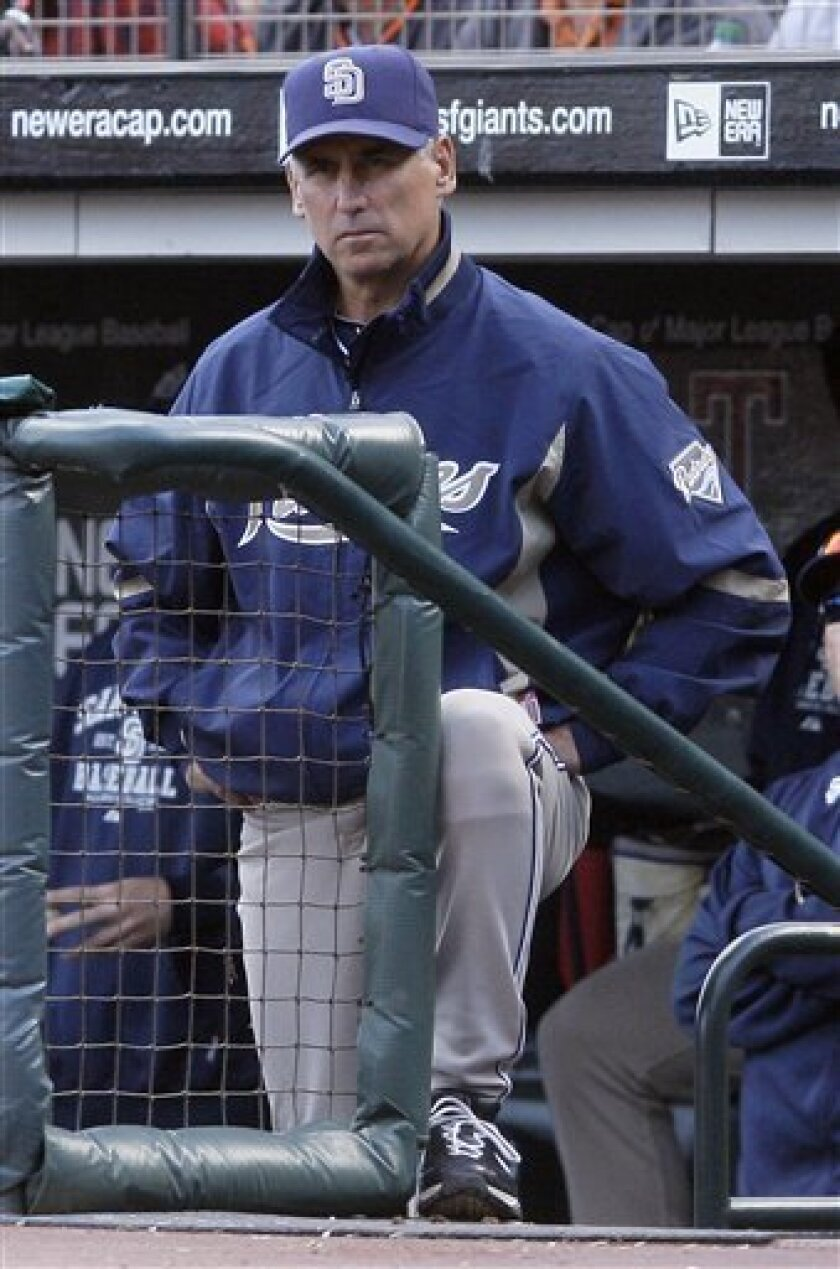 FILE - This Oct. 3, 2010, file photo shows San Diego Padres manager Bud Black watching from the dugout in the eighth inning of a baseball game against the San Francisco Giants,  in San Francisco. Black won the NL Manager of the Year award Wednesday Nov. 17, 2010.  (AP Photo/Jeff Chiu)