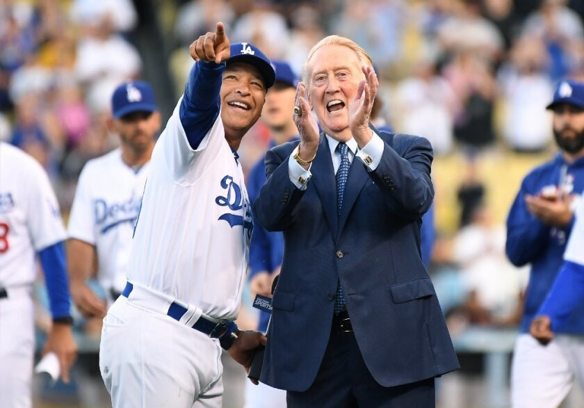 Dodgers manager Dave Roberts and Vin Scully smile during as the former broadcaster is inducted into the Ring of Honor at Dodger Stadium on May 3.