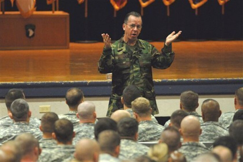 U.S. Navy Adm. Mike Mullen, Chairman of the Joint Chiefs of Staff, discusses the Afghansitan mission with soldiers at Fort Campbell, Ky. Monday, Dec. 7, 2009 (AP Photo/Christopher Berkey)